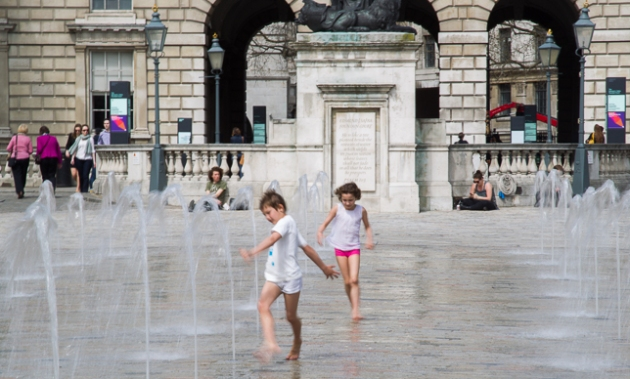 children playing among the fountains outside Somerset House