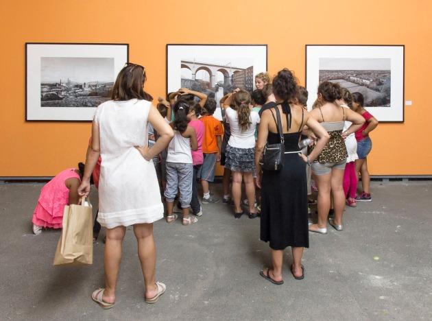 view crowd around a John Davies print