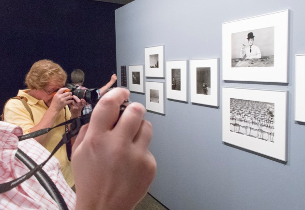 students photographing the Guy Bourdin exhibition