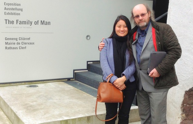 blog author, Amano, with Tibetan friend, Palyang at the entrance to the exhibition