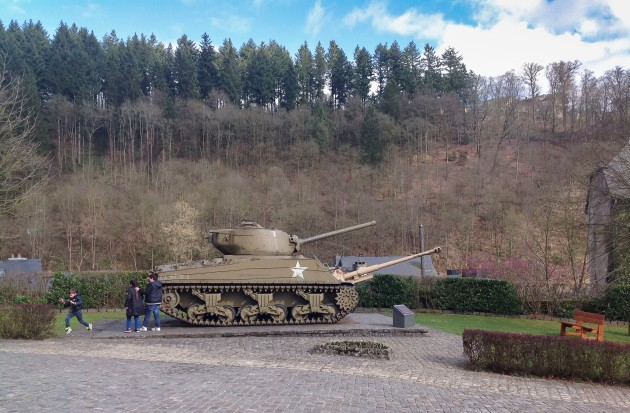 children play on a tank in the grounds of Clervaux Castle which was destroyed during World War 2 since when it has been rebuilt