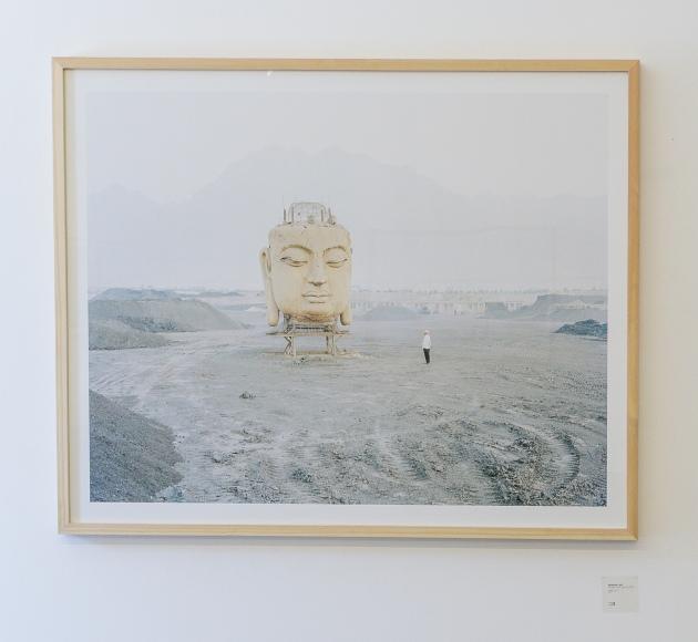 Buddha Head with Muslim onlooker