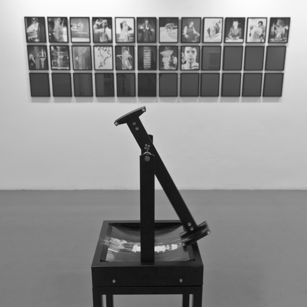 OUTPUT ENTROPY in which photographic prints are degraded by a mechanical device and then hung up on a wall of the gallery