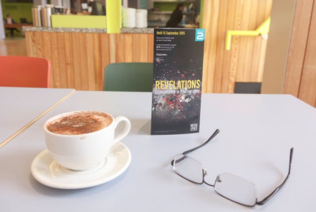 exhibiiton flyer, hot chocolate, glasses